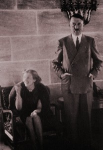 A smiling Eva Braun with an awkward-looking Hitler in the main reception hall