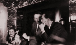 Adolf Hitler in front of the fireplace with Joseph and Helga Goebbels