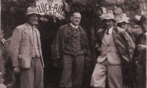 Chief Engineer Hans Haupner with the Reck brothers, as work begins on the tunnel